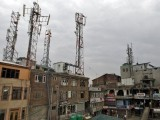 A view of telecom towers installed over the buildings is pictured in Srinagar, June 3. PHOTO: REUTERS