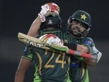 Pakistani batsman Ahmed Shehzad (R) congratulates to his teammate Mukhtar Ahmed after scoring 50 runs against Zimbabwe during the first International T20 cricket match at the Gaddafi Cricket Stadium in Lahore on May 22, 2015. PHOTO: AFP