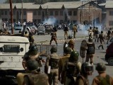 Kashmiri residents and Indian police clash in Srinagar.  PHOTO: AFP