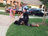A screengrab of a video shows McKinney, Texas, police Officer Eric Casebolt restraining a 14-year-old girl after a pool party.