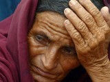 A relative of a heatstroke victim waits at a hospital in Karachi.  PHOTO: AFP