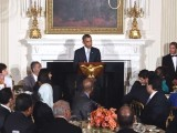 President Obama speaks as he hosts an Iftar dinner in the State Dinning Room at the White House. PHOTO: AFP