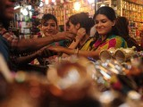 Pakistani Muslim women shop for bangles at a market in Karachi ahead of Eid ul Fitr. PHOTO: AFP
