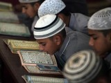 Pakistani students of a madrassa at their seminary in Islamabad. PHOTO: AFP