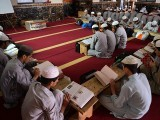 This photograph shows students of a madrassah or Islamic school attend a class at their seminary in Islamabad. PHOTO: AFP