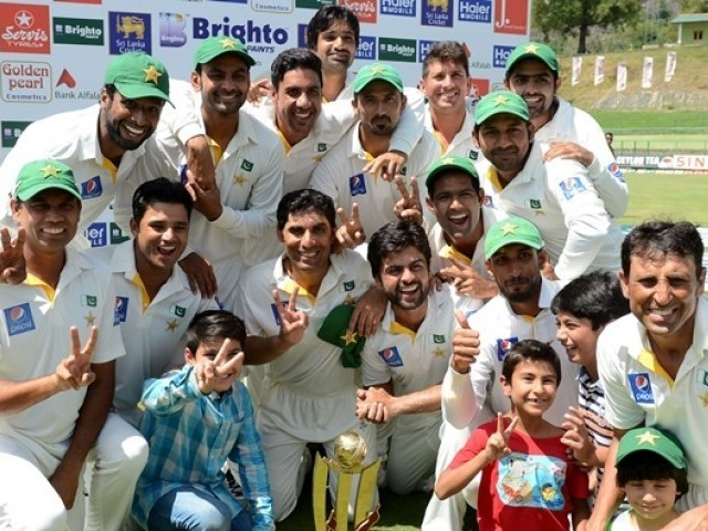 Pakistan cricketers pose after their team's series victory following the third and final Test cricket match between Sri Lanka and Pakistan at The Pallekele International Cricket Stadium in Pallekele on July 7, 2015. PHOTO: AFP