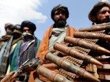 Former Taliban fighters display their weapons as they join Afghan government forces. PHOTO: AFP