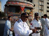 A Pakistani traffic police officer holds a music player that was removed from a passenger bus in Karachi. PHOTO: AFP