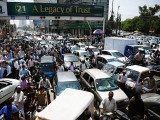 Pakistani commuters are stuck in a traffic jam in Karachi on June 3, 2014 following the arrest of Altaf Hussain, head of Pakistan's MQM party, in London. PHOTO: AFP