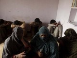 Children who are said to have been abused hid their faces while their mothers were interviewed by a journalist in their village in Punjab Province on Sunday. PHOTO: REUTERS