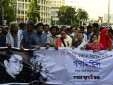 Bangladeshi secular activists take part in a procession to protest against the killing of blogger Niloy Chakrabarti, who used the pen-name Niloy Neel, in Dhaka. PHOTO: AFP