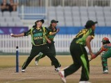 Pakistan cricket player Sana Mir (L) bowls during the women's cricket final against Bangladesh at the Yeonhui Cricket Ground during the 17th Asian Games in Incheon on September 26, 2014.  PHOTO: AFP