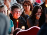 Supporters grieve at a candlelight vigil after the shooting at Reynolds High School in Troutdale, Ore. PHOTO: REUTERS
