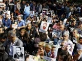 Demonstrators hold portraits of those killed in Saturday's suicide bombings in Ankara. PHOTO: REUTERS