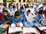 Girls studying in school in KP. PHOTO: AFP