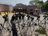 Journalists are seen outside the residence of Pakistan's former President and head of the All Pakistan Muslim League (APML) political party Pervez Musharraf, on the outskirts of Islamabad, April 19, 2013. PHOTO: REUTERS