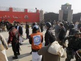 Pakistan University attack: Pakistani troops and rescue workers gather at the main gate of Bacha Khan University in Charsadda town, some 35 kilometers (21 miles) outside the city of Peshawar, Pakistan, Wednesday, Jan. 20, 2016. Gunmen stormed Bacha Khan University named after the founder of an anti-Taliban political party in the country's northwest Wednesday, killing several people, officials said. PHOTO: AP