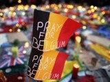 Belgian flags seen at a street memorial service in Brussels following the March 22 bomb attacks PHOTO: REUTERS