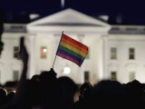 A rainbow flag is held up during a vigil after the worst mass shooting in US history at a gay nightclub in Orlando, Florida, in front of the White House in Washington. PHOTO: REUTERS