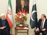 PM Nawaz Sharif speaks with Iranian President Hassan Rouhani at the PM House. PHOTO: AFP