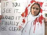 An activist holds a banner during a march against domestic violence against women, marking International Women's Day in Beirut March 8, 2014. PHOTO: REUTERS