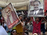 Supporters of MQM shout slogans during a sit-in protest calling for party leader Altaf Hussain's release, in Karachi on June 5, 2014. PHOTO: AFP