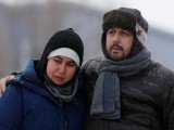 Azzedine Najd (R) and his wife Fadwa Achmaoui look at the memorial near the site of a fatal shooting at the Quebec Islamic Cultural Centre in Quebec City, Canada, January 31, 2017. PHOTO: REUTERS