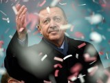 Turkish President Recep Tayyip Erdogan gestures amid confetti during a rally in Istanbul on March 11, 2017. PHOTO: AFP