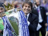 Chelsea's manager Antonio Conte holds the trophy after the English Premier League soccer match between Chelsea and Sunderland at Stamford Bridge stadium in London. PHOTO: AFP