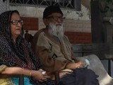 Abdul Sattar Edhi sits with his wife Bilquis Edhi outside his office in Karachi. PHOTO: AFP