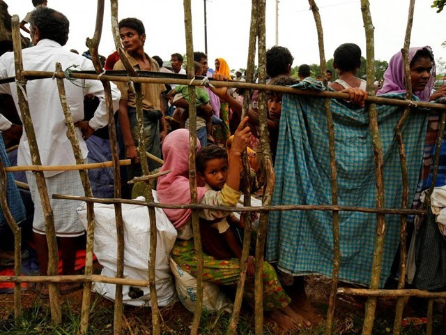 New Rohingya refugees wait to enter the Kutupalang makeshift refugee camp in Cox's Bazar Bangladesh