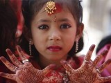 A Newar girl shows her palms decorated with henna to the camera during an Ihi ceremony. PHOTO: REUTERS
