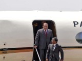 Pakistan's Prime Minister Nawaz Sharif waves upon his arrival at the airport in New Delhi.PHOTO: REUTERS