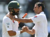 Pakistan captain Misbahul Haq (L) is consoled by teammate and fellow retiree Younis Khan. Photo: AFP