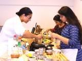 Poppy teaches students how to prepare a green papaya salad, peanut sauce, Pad Thai and chilli chicken. PHOTO: NEFER SEHGAL