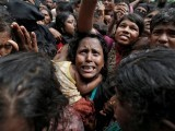 A woman reacts as Rohingya refugees wait to receive aid in Cox's Bazar, Bangladesh, September 21, 2017. PHOTO: REUTERS