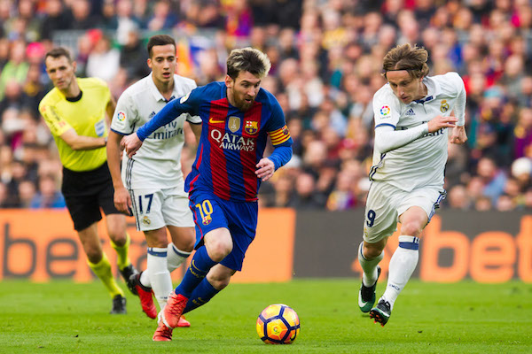 8f45c3040 ... (L) of FC Barcelona conducts the ball next to Luka Modric (R) of Real  Madrid CF during the La Liga match between FC Barcelona and Real Madrid CF  at Camp ...