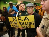 Protesters against the National Rifle Association in Florida during the first appearance in court via video link for high school shooter Nikolas Cruz. PHOTO: AFP