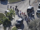 People are brought out of the Marjory Stoneman Douglas High School after a shooting at the school that reportedly killed and injured multiple people on February 14, 2018 in Parkland, Florida. PHOTO: GETTY