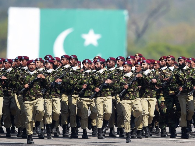 SSG personnel march during the Pakistan Day parade in Islamabad. PHOTO: AFP