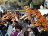 PML-N supporters take part in a march towards the airport ahead of the arrival of Nawaz Sharif in Lahore. PHOTO: AFP