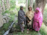 (R to L): Sakina, Khanum and their friend pose for a photo next to a water channel in Siksa Valley, Gilgit-Baltistan. PHOTO: RINA SAEED KHAN