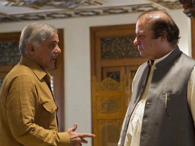 Nawaz Shairf in a conversation with his brother Shehbaz Sharif. PHOTO: REUTERS/ FILE