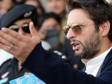 Shahid Afridi gestures while speaking at a ceremony in Peshawar. PHOTO: AFP