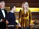 Ada Hegerberg (R) looks on next to French former player and presenter David Ginola and French DJ and co-host Martin Solveig (C) after receiving the women's 2018 Women's Ballon d'Or award for best player of the year on December 3, 2018. PHOTO: AFP