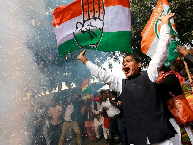 Supporters of the Congress party celebrate election results. PHOTO: REUTERS