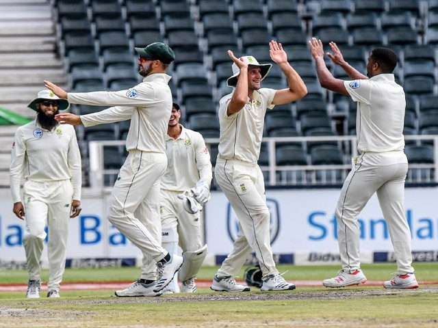 Vernon Philander of South Africa celebrates with team-mates during day 4 of the 3rd Castle Lager Test match between South Africa and Pakistan at Bidvest Wanderers Stadium on January 14, 2019 in Johannesburg, South Africa.