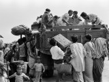 In this photo taken on February 1, 1972, Bengali refugees try to board a truck to return to their country after the Indo-Pakistani War of 1971, in Kolkata. PHOTO: AFP