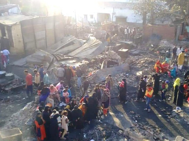 More than 200 homes belonging to Muslims were set on fire in the Bhusa Mandi slum in Meerut. PHOTO: CARAVAN DAILY