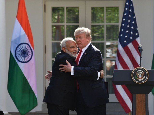 President Donald Trump and Indian Prime Minister Narendra Modi exchanged hugs in the White House Rose Garden in front of reporters. PHOTO: AFP